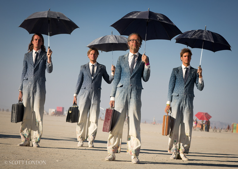 4 men with umbrellas