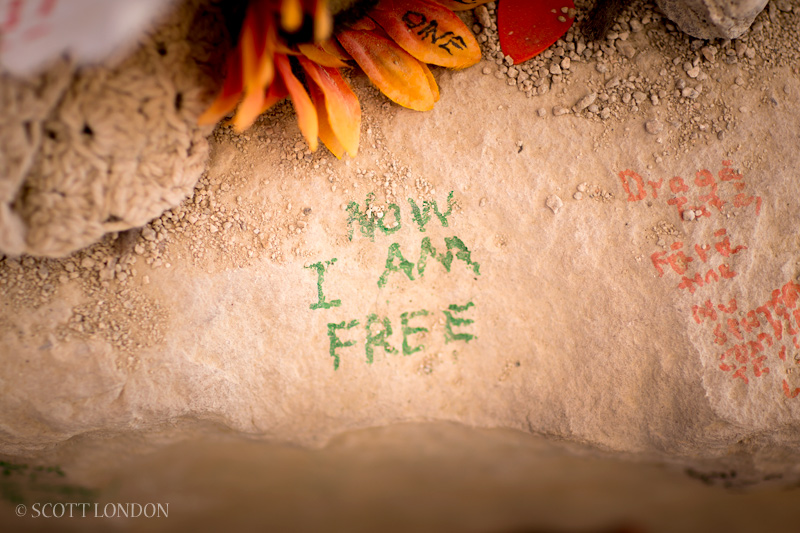 I Am Free Now Message scribbled in stone at