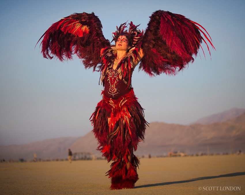 Bay Area artist and costume designer Ka danced at the temple in a red feather embodiment & Burning Man 2014 - Ka and the Phoenix - Photo by Scott London