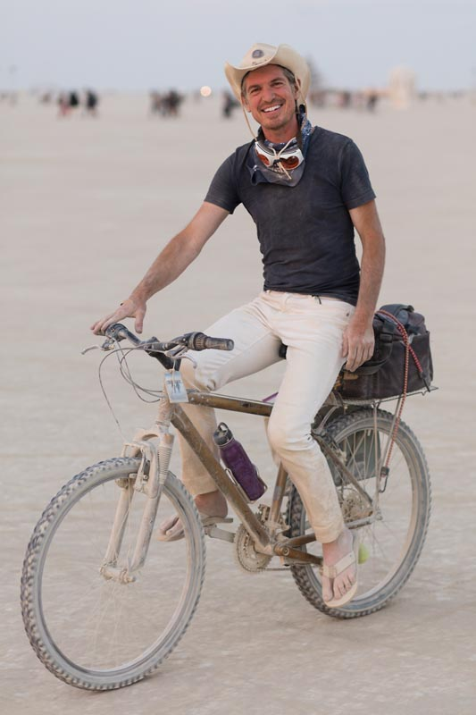 Photographer Scott London on his bike at Burning Man 2016
